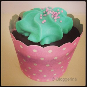 chocolate muffin with pink wrapper and turquoise toping