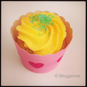 pink red cupcake with yellow toping