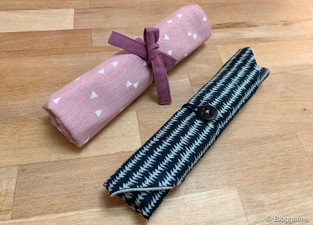 Bestecktaschen eingerollte in rosa und in blau mit Muster